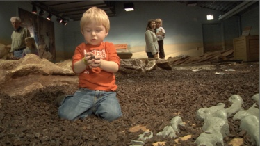 kid in mud